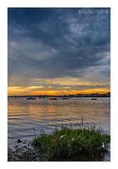 Mudeford Sunset (Nick_Miles) Tags: nikon d7000 mudeford sunset clouds water sky 1870 christchurch landscape view boats dorset evening summer rain storm reflection colours