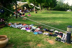 Shoes here ~ (Teteel) Tags: people grass yoga garden shoes athens greece megaron yogaspringfair