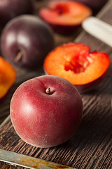 Raw Organic Black Apricot Fruit (brent.hofacker) Tags: red summer food black nature fruits yellow fruit dark dessert juicy healthy furry raw natural sweet juice group harvest violet tasty fresh gourmet delicious health vegetarian apricot peaches organic sliced diet edible homegrown plump apricots vitamins freshness ripe nutrition refreshment ingredient stonefruit vitamin pluot organicfruit blackapricot blackapricots
