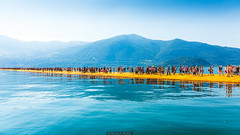 On the lake (Nicola Pezzoli) Tags: blue people italy mountain lake art tourism nature water colors yellow canon reflections island design piers floating monte bergamo brescia lombardia isola iseo sulzano