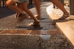 LVM - Un charco /velocidad (Nathalie Le Bris) Tags: street summer water pie foot calle movement agua eau child barrel movimiento heat verano pied t rue enfant nio calor flaque charco mende chaleur