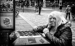The joys of smoking. (Mister G.C.) Tags: blackandwhite bw image streetshot streetphotography photograph monochrome urban town city woman female smoker smoking cigarette eyecontact zonefocus zonefocusing snapfocus ricoh ricohgr pointshoot mistergc schwarzweiss strassenfotografie glasgow scotland britain greatbritain gb british uk unitedkingdom europe