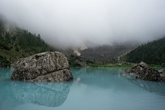Dinosaur Rock (mimo1213) Tags: lake lago dolomites italy italia mountain landscape fog reflection blue glacial outdoor water still