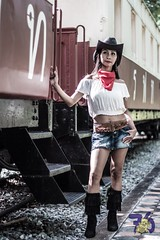 Cowgirl III-1 (Chindit76) Tags: boss sexy girl hat standing train asian thailand model boots outdoor longhair railway skirt jeans western desaturated filipina cowgirl steamengine stetson steamtrain pattaya freighttrain neckerchief watermarked