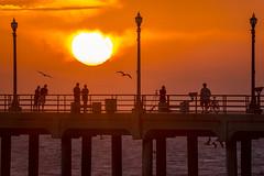 Huntington Beach pier, Orange County CA (arbabi) Tags: california sunset usa sun beach america walk highway1 pacificocean southerncalifornia orangecounty visitors westcoast huntingtonbeach californiacoast huntingtonbeachpier pacificcoasthighway vacationers seanarbabi surfcityusa