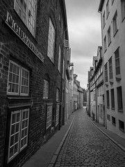 old town in germany (xtj7) Tags: street blackandwhite bw history germany town alley cloudy streetphotography olympus historic historical luebeck lbeck oldtown em1
