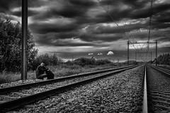 the lonesome traveler (B. Versteeg) Tags: train rails dark clouds alone trein black weather holland nederland nikon d700 rocks wolken dreiging buiten spoorwegen danger