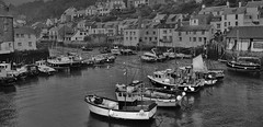 Polperro Harbour, Cornwall, UK. (BrianDerbyshire) Tags: polperro cornwall england uk harbour sea boats fishing rain cloud cottages houses monochrome black white blackandwhite