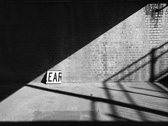 In the ear under a bridge (Jennifer Lea) Tags: ear sign blackwhite bridge underthebridge shadow triangle negativespace light day walks southmelbourne montaguestreet melbourne city