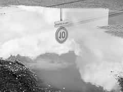 DSCF9248 (PierrickHunter) Tags: rain clouds eau bordeaux pluie reflet inversion signalisation miroir nuages panneau flaque rflection bastide