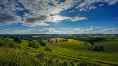 The light from above (TanzPanorama) Tags: nature england scenery summer sony sonyilce7m2 sonya7ii fe1635mmf4zaoss variotessartfe1635mmf4zaoss zeiss clouds sunlight sunstar wideangle tanzpanorama flickr panorama countryside cissburyring sussex southdowns light shadow