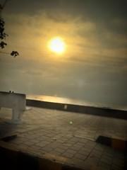 The best seat in town (arifhemdani) Tags: placetobe bench sun beautiful serene evening pavement sunset seaface worli