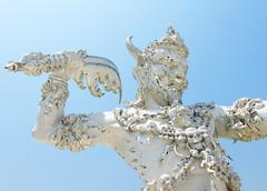 White Temple: Guardian Sculpture (shaire productions) Tags: travel sculpture detail art architecture thailand outdoors temple design exterior image artistic buddhist picture buddhism structure architectural creation photograph thai demon chiangmai wat guardian chiangrai w