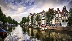 Painting the Town Amsterdam (Presetpro) Tags: adobelightroom adobelightroompresets amsterdam aurorahdr bikes blendinglight bluehour bluesky buildings canals canon1635mm cityscape clouds cloudy cobblestreets exposurevalue hdr hdrphotography highdynamicrange lightroomediting lightroompresets lightroompresetspack lightsreflecting netherlands pastelcolours pastelhomes photomatix photomatixpresets photoshop rainclouds reflections reflective sunset tim timmartin travel travelphotography tripod tripods watercanals watertaxi