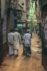 Walking down the street (Syahrel Azha Hashim) Tags: community nikon cramped city shallow holiday pc9 simple indian details india architecture local dof building asia view moment people olddelhi buildings 2015 vacation 35mm prime light highdensity naturallight traditionalclothing colorful humaninterest d300s travel syahrel handheld getaway street streetphotography colorimage rajasthan alley detail