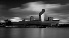 mono evening (neals pics) Tags: my100xbw bw blackwhite monochrome blackandwhite mono manchester reflections lights england night longexposure urban architecture buildings salfordquays river mediacityuk iwm iwmnorth museum clouds 100xthe2016edition 100x2016 image50100