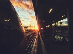 Into the light. (christiannass) Tags: germany deutschland street photo iphone iphoneonly iphoneography moments decisive moment creative explore camera sunset photography train station leading lines travelling sky clouds sun