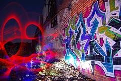 Light Graffiti Vs Graffiti (jna.rose) Tags: longexposure sky lightpainting brick abandoned broken glass colors night dark lights graffiti colorful slow outdoor urbandecay gang cups nighttime urbanexploration slowshutter shutter abandonedbuilding abandonedfactory