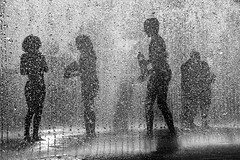 Summer Heat (instagram.com/the_big_smoke_/) Tags: summer heat hot water jets cooling silhouettes street london streetphotography streetscene streetphoto streets central city centre composition contrast capture highspeed photography england britain bw blackandwhite southbank children playing fun people peoplewatching compo streetcomp mono monochrome robmchale wow