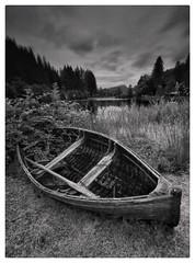 On dry land (theclashcityrocker) Tags: scotland monochrome blackwhite boat aberfoyle canon snapseed