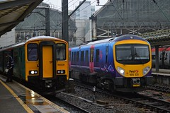150231 and 185131, Manchester Piccadilly (JH Stokes) Tags: 150231 class150 class1502 dmu arrivatrainswales atw sprinters 185131 class185 transpennineexpress tpe manchesterpiccadilly manchester rain trains trainspotting tracks transport railways photography