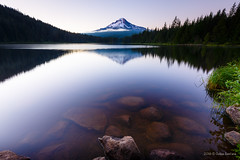 Inspiration is everywhere  from the words of your favorite writer to the silence of nature on the edge of a lake. You just need to open your eyes, and breathe it in. (ozeias) Tags: freedom usa landscape naturallight nature water exploration canon longexposure rocks vacation sun summer peace oregon beautiful travel exposure trilliumlake northamerica wildlife sunlight wonder sunny quiet lake governmentcamp unitedstates us
