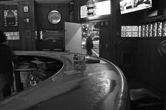 Jonell's, Tenderloin - San Francisco, CA (Rex Mandel) Tags: bar divebar tenderloin tl sanfrancisco sf blackandwhite bw street streetphotography curvedbar curvedlines glassbrick night noir monochrome