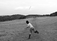 Afternoon play (Rebekah *) Tags: elements dunravencastle wales southerndown outdoor monochrome blackandwhite blackwhite playing coast outside countryside grass path throwing stick running