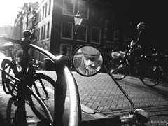 Reflection (Rolling Spoke) Tags: street leica bridge light shadow blackandwhite reflection monochrome amsterdam bike bicycle lumix mirror canal bicicleta bici bnw fiets selfie gx1