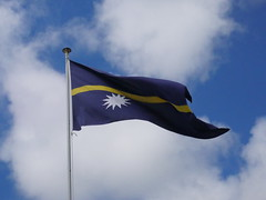 The flag of Nauru. Blue means ocean, yellow means equator and The star with 12 tips is The 12 clans that owe all lands in Nauru.