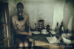 Supper Time (micahmoreland) Tags: creepy horror surreal surrealism surrealist conceptual costume wheezer world war 2 ii dystopian scary haunting wet plate grunge texture male toxic death danger gas mask thin skinny abandoned house urbex urban exploration kitchen disturbing comical