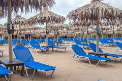 IMG_9033800px (Geoff Tydeman) Tags: sunbeds umbrellas beach