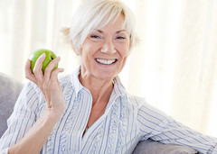 healthysenior (statemutualinsurance) Tags: 50s activeseniors agingprocess beautiful casual caucasian colorimage enjoyment female freshness happiness healthyeating healthylifestyle independence lifestyles livingroom looking matureadult oneperson photography senioradult seniorwomen sitting smiling vitality wellbeing alone apple blonde charming food fruit holding home joy maturewoman natural onewoman onewomanonly portrait realpeople toothysmile vertical white woman