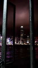 Behind the bars.. (Master Octa) Tags: canon powershot sx50 sx50hs canonpowershotsx50hs tower skyscraper highrise hirise building office hotel resort shoppes shop shoppingmall shopping mall skyline cbd downtown city cityscape vertical water waterfront bayfront night nightshot lowlight noflash lowexposure hk hkg hongkong china chinapr hongkongsar light color colour colorful colourful portrait victoriaharbor harbour tsimshatsui victoriaharbour pier starferry starferrypier central ifc ifcmall
