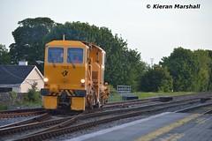 703 departs Portlaoise Station Loop, 6/6/15 (hurricanemk1c) Tags: irish train rail railway trains railways irishrail pwd portlaoise 703 2015 iarnród éireann iarnródéireann ballastregulator plasserandtheurer usp4000
