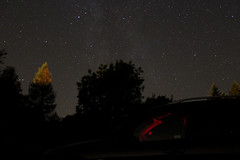 Park Under the Milky Way (Venvierra @ GothZILLA Photography) Tags: gothzillaphotography canon 600d canon600d eos canoneos canoneos600d stars starscape nightsky night starrynight weather clearskies sky starrysky starry astrophotography trees powhill derwent reservoirmilky way car