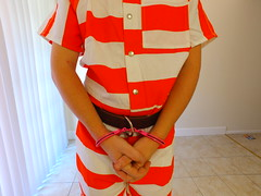Orange Striped Uniform (boblaly) Tags: orange white stripes jumpsuit prisoner inmate detention handcuffs belly chain restraints shackles shackled prison jail uniform cuffed belt tubes