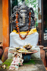 Ganesha (Evgeny Ermakov) Tags: asia asian bali ganesh ganesha god hindu hinduism indian indonesia southeast southeastasia ubud culture deity elephant flower garland gift necklace offering orange plate religion religious sit spirituality statue traditional yellow