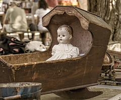 Baby doll (mgstanton) Tags: fleamarket antiques doll babydoll creepy cradle on1pics