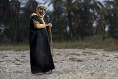 Shepherd (ali darwish233) Tags: lighting old people man photography photo bahrain sheep shepherd arab علي تصوير راعي photogarpher صحراء قديم درويش مصور alidarwish
