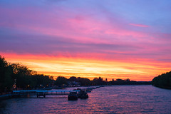 London sunset from Putney Bridge (andyc246) Tags: uk pink blue light england orange london texture water beautiful yellow clouds zeiss reflections landscape golden cityscape colours purple scenic magenta dramatic beautifullight windy ripples bluehour colourful lovely riverthames embankment goldenhour putneybridge boathouses riverscape putneypier