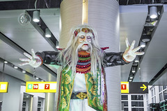A Balinese spirit watches over passengers. (wrightontheroad) Tags: denpasarairport ngurahraiinternationalairport ngurahraiairport airport demon denpasar bali indonesia