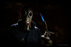 The Inquisitor (isitaboutabicycle) Tags: memyselfandi inquisitor gasmask blowtorch texture xt10 selfie selfportrait flame blueflame gas lowkey dark portrait boilersuit sinister samyang12mmf2ncscs propane propanetorch