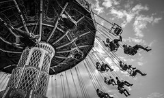Into the Clouds (tim.perdue) Tags: clouds wave swinger wellenflieger sky midway ride ohio state fair summer carnival people figures black white bw monochrome