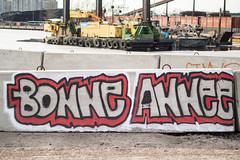 Bonne Annee (Jori Samonen) Tags: graffiti bonne annee gravel concrete ice dredging ferry buildings pile background sompasaari helsinki finland nikon d3200 350 mm f18 coal bonneannee dredge barge