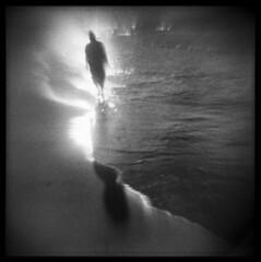 Ocean's Edge (LowerDarnley) Tags: agfaisoly modifiedcamera pei princeedwardisland lower darnley beach ocean sunset walker figure atlanticcanada maritimes np22 orwo