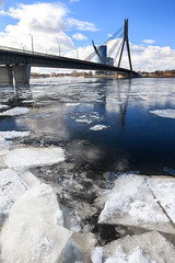 Floating of ice at the bridge on the Daugava in Riga in spring (Viktor Descenko) Tags: city bridge blue sky urban white snow building ice nature water beautiful river season landscape spring cityscape edmonton waterfront view riverside outdoor seasonal north scenic floating scene baltic latvia blocks iced icy float riga daugava icebound