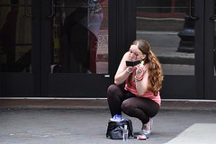 Touch-Up on the Street (AntyDiluvian) Tags: street woman girl boston massachusetts makeup ponytail downtowncrossing washingtonstreet hunched