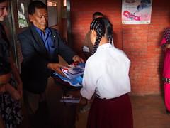 Bijaya giving supplies to sponsored student (The Advocacy Project) Tags: asia kathmandu nepal concernnepal bricks2books education childlabor childrights earthquake children childhood trabajoinfantil travaildesenfants advocacyproject betterbricks bhaktapur donate