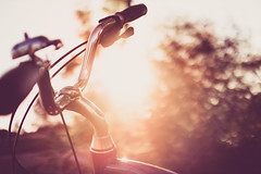 Curved bicycle handlebar at sunset light (thethomsn) Tags: sunset sundown bicycle dof bokeh backlight lenker fahrrad handlebar light outdoor detail focus lightroom5 sigma deutschland germany bright dreamy bike curved retro lifestyle summer closeup thethomsn